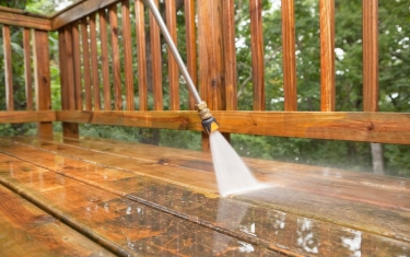 pressure-washer-cleaning-a-weathered-deck-171356261-5810fd5d5f9b58564c69c9c6